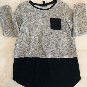 "Pocket ""layered"" sweater"